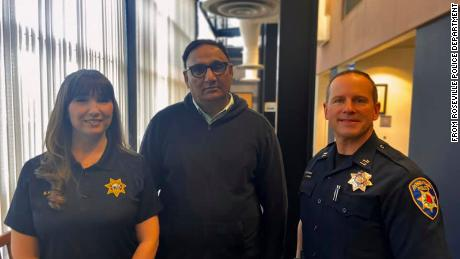 Rajbir Singh saved an elderly passenger in his cab from giving a scammer $25,000 in Roseville, California. He is flanked by Roseville Police records clerk Megan Harrigan and police Capt. Josh Simon.