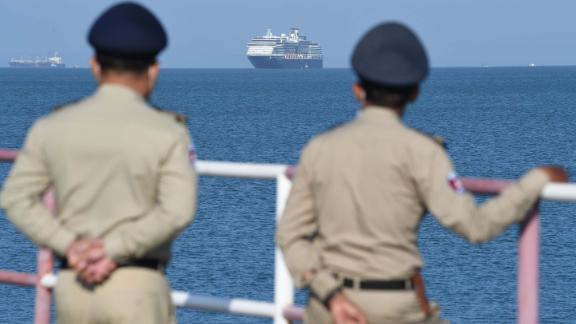 Authorities watch as the Westerdam cruise ship approaches a port in Sihanoukville, Cambodia, on February 13. Despite having no confirmed cases of coronavirus on board, the Westerdam was refused port by four other Asian countries before being allowed to dock in Cambodia.
