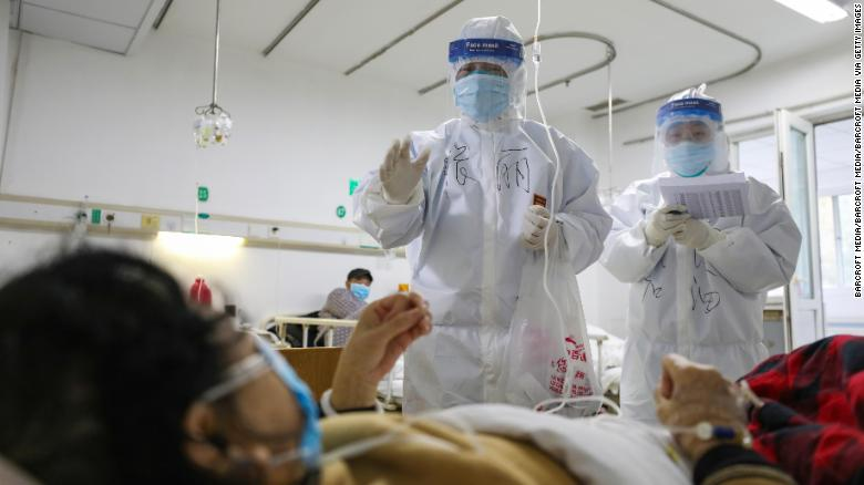 Medical personnel check the conditions of patients in Jinyintan Hospital, designated to treat coronavirus patients, in Wuhan.