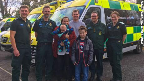 Jayne Rowland, her partner, Joshua Mogg, and her sons thanked ambulance staff after they talked her through giving birth on the highway.