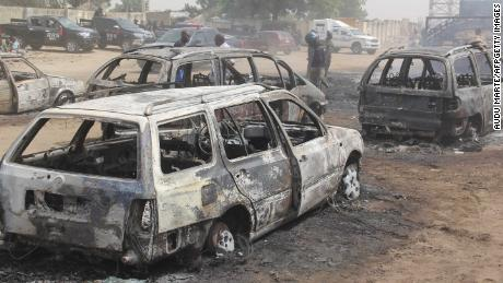 Cars burnt by suspected militants in the attack.