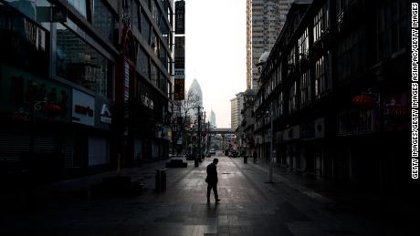 A man walks on an empty street in Wuhan, China, on February 13, 2020.