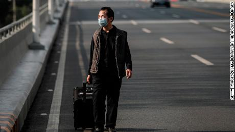 A man wears a protective mask as he walks in Wuhan on February 13, 2020.
