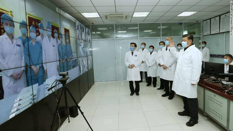 Chinese President Xi Jinping talks to medical staff on duty via a video link at Beijing Ditan Hospital in Beijing on Febuary 10.
