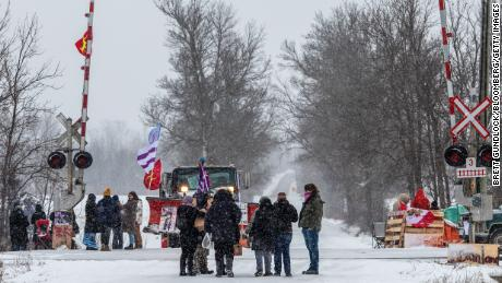 Demonstrators stand near railway tracks during a protest near Belleville, Ontario, on Thursday.