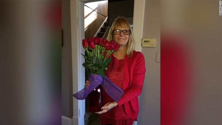 Tracey with Rich's flower arrangement from 2016.