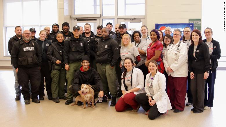 Nipsey with his owner, Detroit police, and the Michigan Humane Society.
