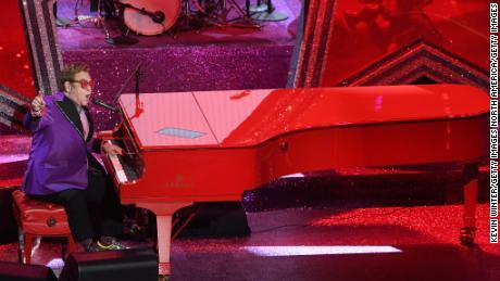 Elton John says he has walking pneumonia on tour