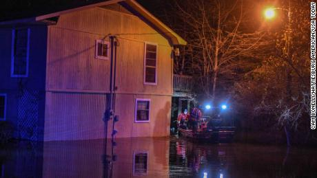 Emergency personnel rescued Janis Hart Landrum from her home as water from the Pearl River rose Saturday night.