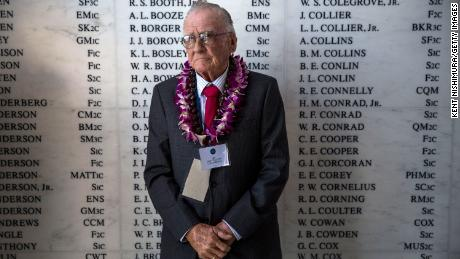 USS Arizona survivor, Donald Stratton, stands in front of the remembrance wall at the USS Arizona Memorial in 2014. Stratton died February 15 at age 97.