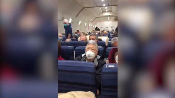 Image for An American evacuated from Japan on a US charter flight says she didn't know people on the plane had tested positive for coronavirus until it landed