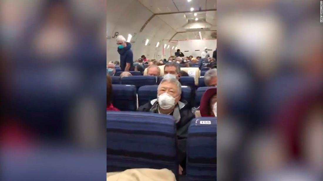 An American evacuated from Japan on a US charter flight says she didn't know people on the plane had tested positive for coronavirus until it landed