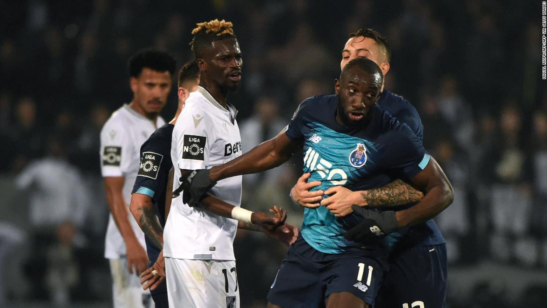 Moussa Marega attempts to leave the pitch after hearing racists chants.
