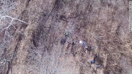 The man is rescued from the woods in this frame grab from drone video.
