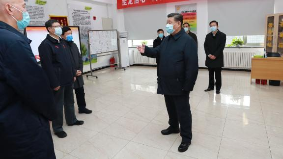 BEIJING, Feb. 10, 2020  -- Chinese President Xi Jinping, also general secretary of the Communist Party of China  Central Committee and chairman of the Central Military Commission, inspects the novel coronavirus pneumonia prevention and control work in Beijing, capital of China, on Feb. 10, 2020. Xi visited Anhuali Community, Chaoyang District of Beijing to learn about the epidemic prevention and control at the primary level and the supply of daily necessities. He also extended regards to residents and community workers. (Photo by Pang Xinglei/Xinhua via Getty Images)
