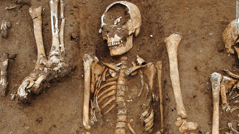 The remains of 48 people who were buried in a 14th century Black Death mass grave were found in England's Lincolnshire countryside.