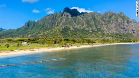 Aerial view of the beach and park at Kualoa with Ko'olau mountains in the background