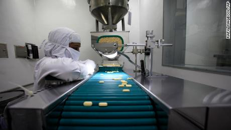 A pharmacist is seen working in a lab where medicines are being produced at a Cipla manufacturing unit on the outskirts of Mumbai, India, Thursday, Feb 9, 2012.