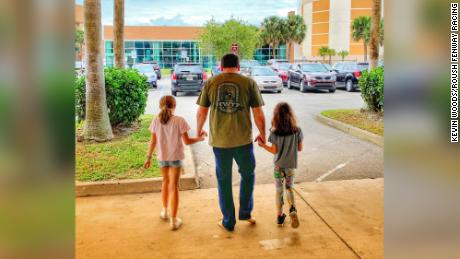 Ryan Newman, with his daughters, leaving the hosptial after the crash.