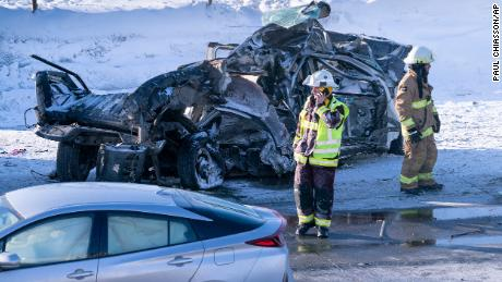 Emergency personnel gather at the scene following a multi-vehicle crash on the south shore of Montreal in La Prairie, Quebec, on Wednesday, February 19, 2020.