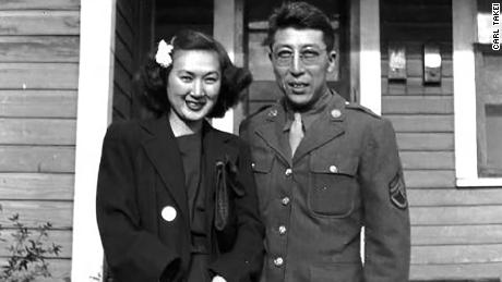 Bette and Kuichi Takei in front of their military housing in Hattiesburg, Mississippi.
