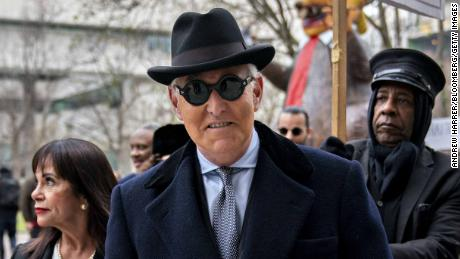 Roger Stone, former adviser to Donald Trump's presidential campaign, center, and his wife Nydia Stone arrive at federal court in Washington, D.C., U.S., on Thursday, Feb. 20, 2020. Stone's sentencing on Thursday is shaping up as a test of judicial independence after President Donald Trump inserted himself in the court's deliberations over the fate of his longtime confidant. Photographer: Andrew Harrer/Bloomberg via Getty Images