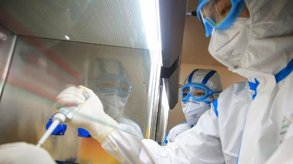 TOPSHOT - This photo taken on February 19, 2020 shows laboratory technicians testing samples of virus at a laboratory in Hengyang in China's central Henan province. - The death toll from the COVID-19 coronavirus epidemic jumped to 2,112 in China on February 20 after 108 more people died in Hubei province, the hard-hit epicentre of the outbreak. (Photo by STR / AFP) / China OUT (Photo by STR/AFP via Getty Images)