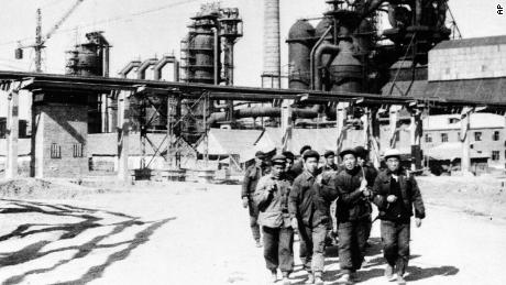 A group of laborers in front of the first blast furnace of the new steel-producing center being built in Wuhan, China, in 1959.