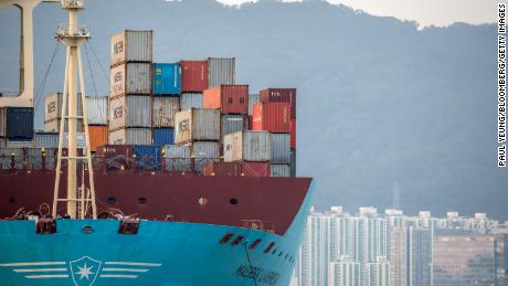 Shipping containers sit aboard a Maersk cargo ship in Hong Kong.