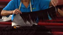 A worker assembles  hair extensions at a factory in Taihe, in China's eastern Anhui province.