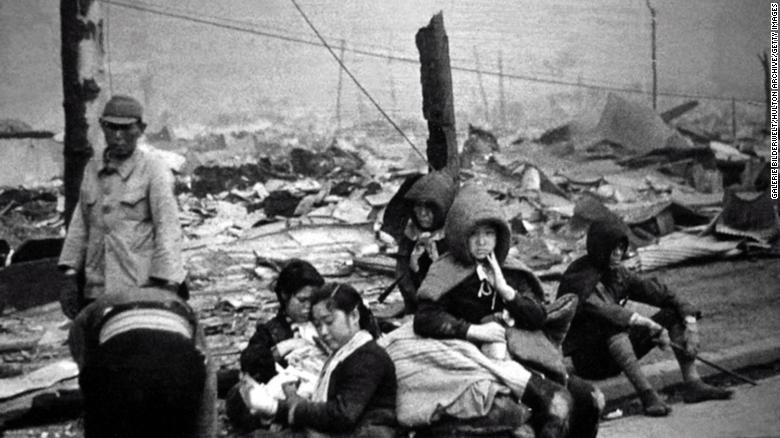 "Tokyo residents who lost their homes as a result of the US bombing air raid ""Operation Meetinghouse"" conducted on March 10, 1945. That air raid was later estimated to be the deadlist in history."