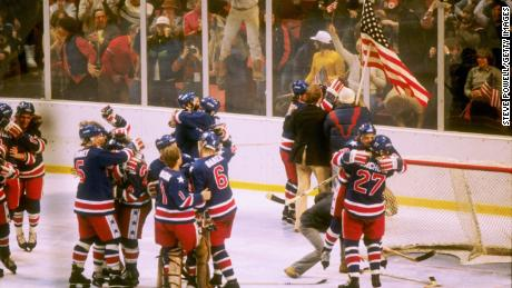 The team celebrates winning the gold medal after defeating Finland 4-2 during the 1980 Winter Olympics on February 24, 1980 in Lake Placid, New York.