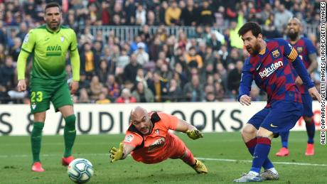 Lionel Messi slots home his fourth goal past a despairing Eibar goalkeeper in the closing stages of the 5-0 win at the Camp Nou.