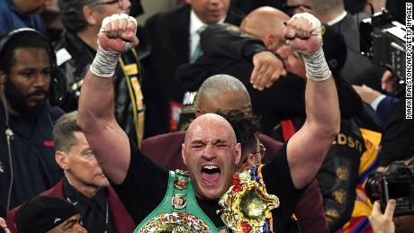 British boxer Tyson Fury celebrates after defeating US boxer Deontay Wilder.