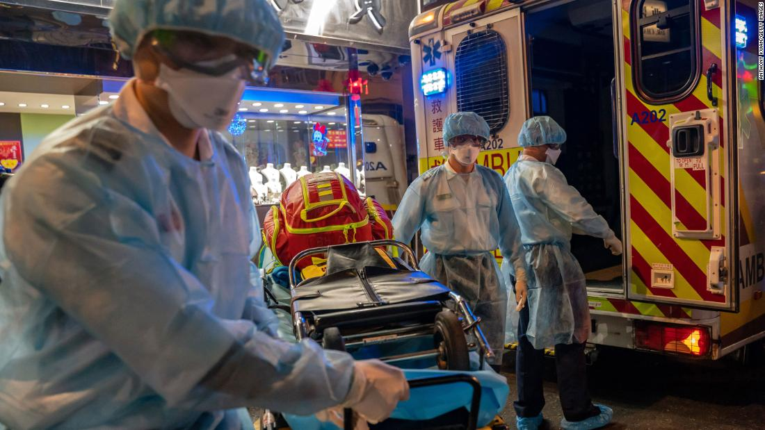 Paramedics carry a stretcher off an ambulance in Hong Kong on February 23.