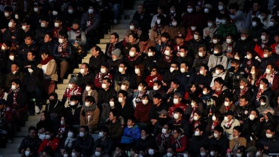 "People attend a professional soccer match in Kobe, Japan, on February 23. To help stop the spread of the novel coronavirus, the soccer club Vissel Kobe <a href=""https://www.espn.com/soccer/vissel-kobe/story/4057914/iniestas-vissel-kobe-ban-singing-chanting-due-to-coronavirus-threat"" target=""_blank"" target=""_blank"">told fans not to sing, chant or wave flags</a> in the season opener against Yokohama FC."