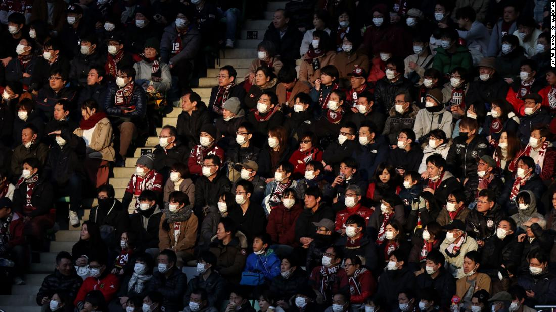 "People attend a professional soccer match in Kobe, Japan, on February 23. To help stop the spread of the novel coronavirus, the soccer club Vissel Kobe <a href=""https://www.espn.com/soccer/vissel-kobe/story/4057914/iniestas-vissel-kobe-ban-singing-chanting-due-to-coronavirus-threat"" target=""_blank"">told fans not to sing, chant or wave flags</a> in the season opener against Yokohama FC."