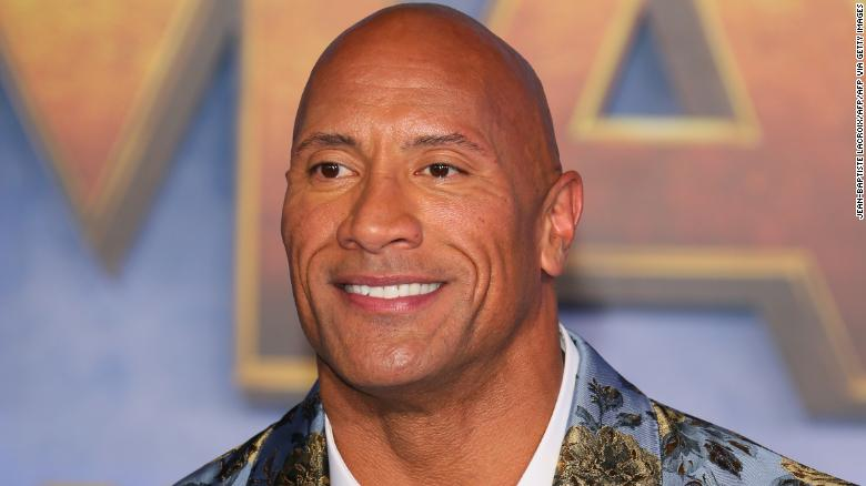 """US actor Dwayne Johnson arrives for the World Premiere of """"Jumanji: The Next Level"""" at the TCL Chinese theatre in Hollywood on December 9, 2019."""