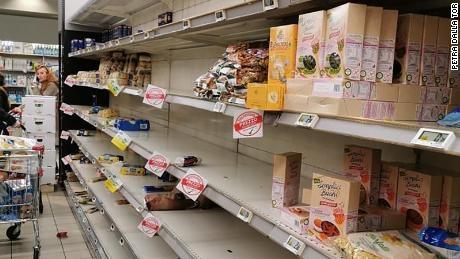 A half-empty supermarket shelf in Milan.
