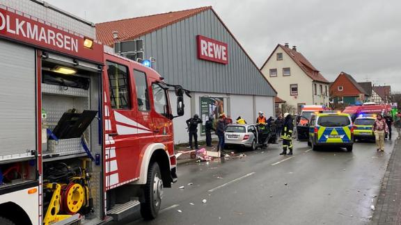 People react at the scene after a car ploughed into a carnival parade injuring several people in Volkmarsen, Germany February 24, 2020.     Elmar Schulten/Waldeckische Landeszeitung via REUTERS.      NO RESALES. NO ARCHIVES