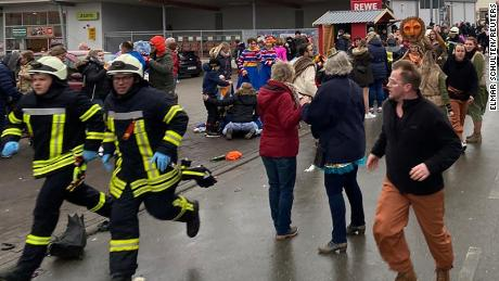People react at the scene after a car ploughed into a carnival parade in Volkmarsen, Germany.
