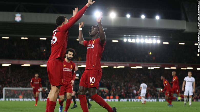 Sadio Mane celebrates after scoring his sides third goal.