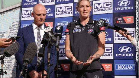Harris speaks next to Carlton CEO Cain Liddle during a press conference at Ikon Park.