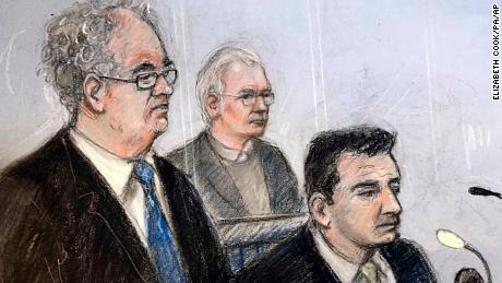 An illustration of Julian Assange, centre, in the dock with his defence team Monday.