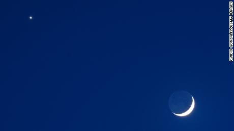 From the Northern Hemisphere perspective, the bright planet Venus will appear next to a crescent moon Thursday night, February 27.