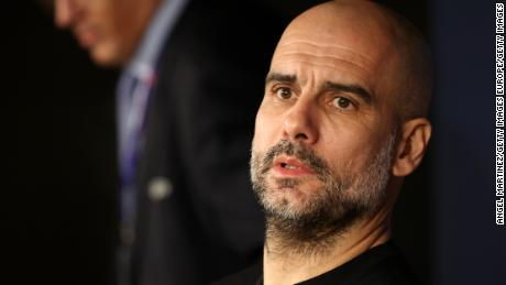 Pep Guardiola speaks with reporters ahead of Man City's round-of-16 tie against Real Madrid.