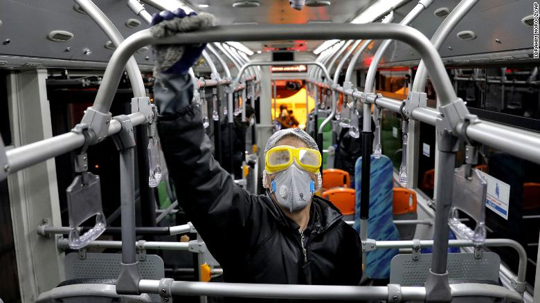 A worker disinfects a public bus amid efforts to contain the coronavirus in Tehran on Wednesday.