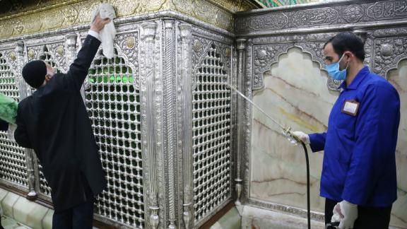People disinfect Qom's Masumeh shrine in Tehran, Iran, on February 25.