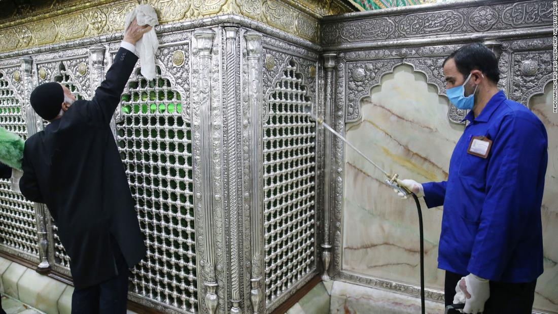 People disinfect Qom's Masumeh shrine in Tehran, Iran, on February 25.