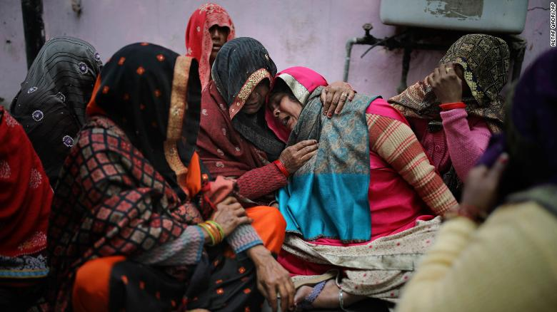 Family members mourn a relative killed in clashes.